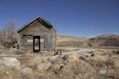 Old abandoned delapitating shack. In the desert Royalty Free Stock Photo