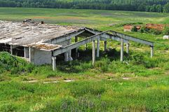 Old abandoned destroyed farm building Royalty Free Stock Photos