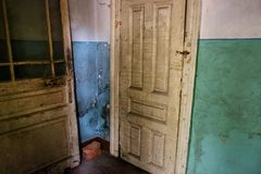 Old abandoned destroyed shabby soviet building interior with chi Royalty Free Stock Photo