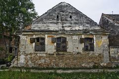 Old devastated house. An old abandoned and devastated farmhouse that is prone to decline Royalty Free Stock Photos