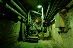 Old abandoned dirty empty green factory interior Stock Photography
