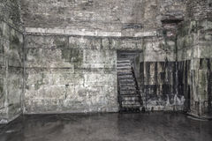 Old abandoned dungeons or catacombs. Stock Photos