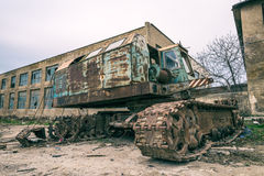Old abandoned excavator in yard Stock Photography