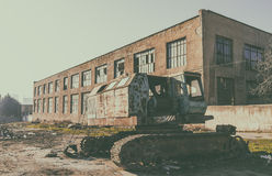 Old abandoned excavator in yard Stock Images