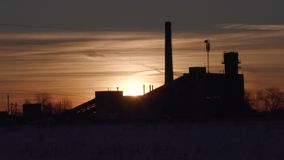 Old abandoned factory on the background of the setting sun in winter timelapse video stock video