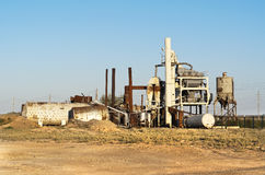 Old abandoned factory. Central Asia. Old asphalt plant Royalty Free Stock Images