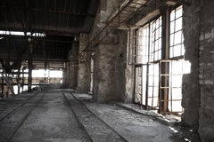 Old abandoned factory. Old abandoned industrial factory interior Stock Images