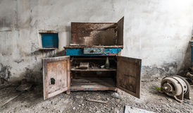 Old abandoned factory. Metal cabinet Stock Image