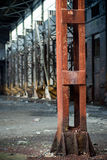 Old abandoned factory metal pole Stock Image