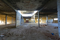 Old abandoned factory. View of an Î¿ld abandoned industrial factory interior stock images