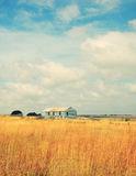 Old abandoned farm in field Stock Images