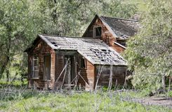 Old Abandoned Farm House. Old abandoned Homestead in ruins on a ranch royalty free stock photos