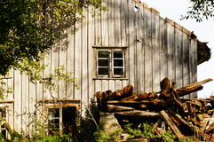 Old abandoned farm house, Norway. An old falling down farm house Telemark, Norway. Norwegian oldest wooden grey farm house. Old abandoned norwegian farm house Stock Image