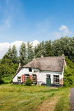 Old abandoned farm house with thatched roof Stock Photography