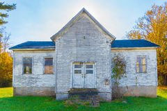 Old Abandoned farm house. An old white abandoned farm house in the fall stock photos