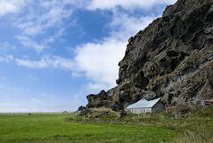 Old abandoned farm, Iceland. Old abandoned farm built at the lava rock edge Stock Photo