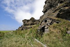 Old abandoned farm, Iceland. Old abandoned farm built at the lava rock edge Stock Images