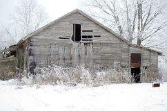 Old abandoned farmhouse. It`s an old banger in frost - winter in the village Stock Photography