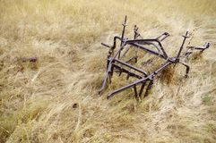 Old abandoned farming equipment. Stock Photo