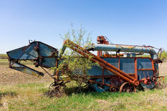Old abandoned farming equipment in a meadow Royalty Free Stock Photos