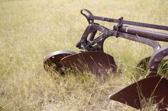 Old abandoned farming equipment. Old abandoned plow in a field in Wyoming Stock Photography