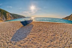 Old Abandoned Fishermen Boat at Sunset Myrtos Beach in Kefalonia, Greece Stock Image