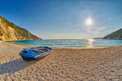 Old Abandoned Fishermen Boat at Sunset Myrtos Beach in Kefalonia, Greece Stock Photo