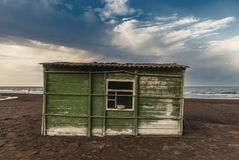 Old abandoned fishing house by the sea. Shore stock images