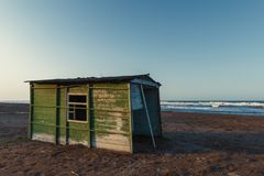 Old abandoned fishing house by the sea. Scene royalty free stock photos