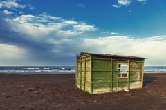 Old abandoned fishing house by the sea. Shore royalty free stock images