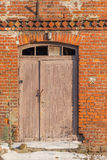 Old, abandoned and forgotten building. Of red brick - door stock photos