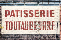 Old abandoned french bakery shop sign on a  brick wall Stock Photo