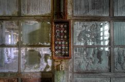Old abandoned fuse box. Old fuse box in an abandoned hall stock photos
