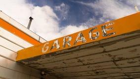 Old Abandoned Garage Building Overhang Orange Sign Stock Photos
