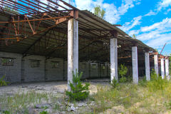 An old abandoned garage for repairing vehicles in the zone. Royalty Free Stock Photography