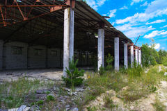 An old abandoned garage for repairing vehicles in the zone. Stock Photos