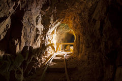 Old Abandoned Gold Mine. Inside an Abandoned Gold Mine with ore cart tracks royalty free stock photo