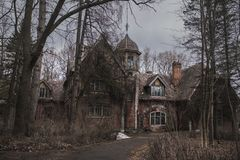 Old Abandoned Gothic House. The Ruined Mansion Stands In The Park. Gothic Background. Halloween Party Place Stock Photo