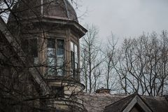 Old Abandoned Gothic House. The Ruined Mansion Stands In The Park. Gothic Background. Halloween Party Place. Scary House. Window Royalty Free Stock Photo