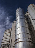 Old abandoned grain silo. Looking up an abandoned grain silo on a partly cloudy day-agriculture Stock Photography