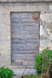 Old, abandoned, gray, wooden door on building Stock Images