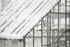 Old, abandoned greenhouse in the snow Stock Photos