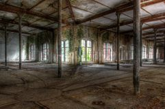 Old abandoned hall with rails Royalty Free Stock Image