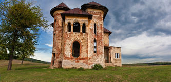 Old abandoned haunted house and sky in Transylvania with clouds Stock Image