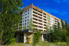 Old abandoned high-rise buildings in a dead radioactive zone. Stock Photo
