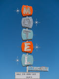Old abandoned highway motel sign. Colorful sign in front of an abandoned motel Royalty Free Stock Photo