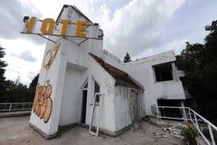 Old abandoned hotel. Devastated ruin royalty free stock image