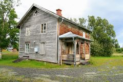Old abandoned house. Old abandoned uninhabitable house in a rural landscape Royalty Free Stock Photo