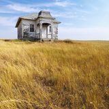 Old abandoned house. Weathered abandoned building in remote grassland Royalty Free Stock Images