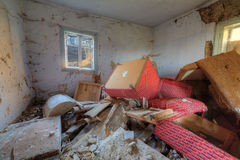 Old abandoned house. Big mess in abandoned forgotten rural house Stock Images